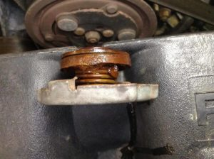 What causes rust in a cooling system?